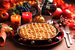 Apple pie for Thanksgiving. With wine and grapes Royalty Free Stock Photo