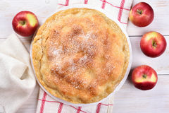 Apple pie, top view. Apple pie on white wooden background, top view royalty free stock images
