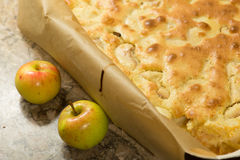 Apple pie with two apples Royalty Free Stock Image