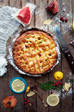 Apple pie on vintage wooden background texture. Top view. Homemade apple pie, apples on the wooden table. Rustic food style. Royalty Free Stock Image