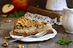 Apple pie with walnut and sugar glaze. Royalty Free Stock Image