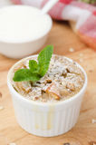 Apple pie with walnuts and mint in a white ramekin closeup Stock Images