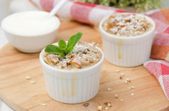 Apple pie with walnuts and mint in a white ramekin horizontal Royalty Free Stock Photography