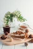 Apple pie with whipped cream covered by grated chocolate Royalty Free Stock Photo