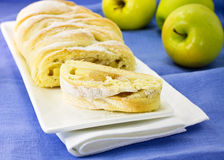 Apple pie on a white dish. Handmade apple pie on a white dish royalty free stock photography