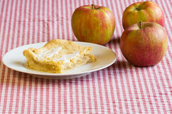 Apple pie on white plate with apples Stock Photos