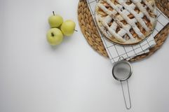 Apple pie with white towel on grey background. Dessert. Homemade cake with black tea and sieve. Autumn flatlay. Autumn homemade pi. Apple pie with white towel on royalty free stock images