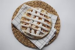 Apple pie with white towel on grey background. Dessert. Homemade cake with black tea and sieve. Autumn flatlay. Autumn homemade pi. Apple pie with white towel on stock photography