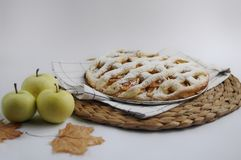 Apple pie with white towel on grey background. Dessert. Homemade cake with black tea and sieve. Autumn flatlay. Autumn homemade pi. Apple pie with white towel on royalty free stock photos