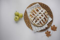 Apple pie with white towel on wooden tray. Dessert. Homemade cake with apples. Autumn flatlay. Autumn homemade pie. Apple pie with white towel on wooden tray royalty free stock image