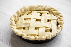 Apple pie on white wooden background, low angle view. Closeup.  royalty free stock photo