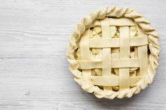 Apple pie on white wooden background, top view. Flat lay, overhead, from above. Copy space.  stock photo