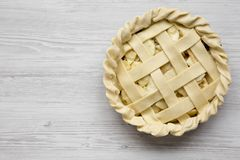 Apple pie on a white wooden table, overhead view. Copy space.  royalty free stock image