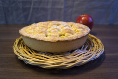 Apple pie. Apple pie in a wicker platen Royalty Free Stock Photography