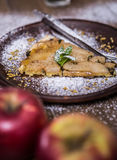 Apple pie on a wooden background with apples Royalty Free Stock Photo
