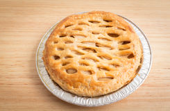 Apple pie on wooden board Royalty Free Stock Photos
