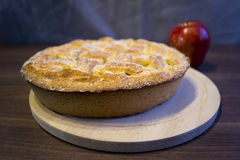 Apple pie. Apple pie on a wooden Board.n Stock Photos