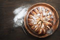 Apple pie on wooden table. Stock Photo