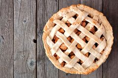Apple pie with woven pastry, above on rustic wood. Rustic homemade apple pie with woven pastry, above view on rustic wood Stock Images
