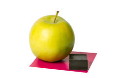 Apple, a piece of chocolate and a square of paper. On a white background Stock Photography