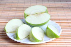 Apple pieces on the plate Stock Photography