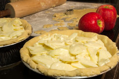 Apple pies ready for the oven with apples Stock Photography
