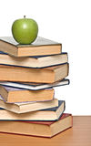Apple on pile of books Stock Photo
