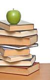 Apple on pile of books Stock Photo