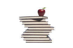Apple and pile of books on white background Royalty Free Stock Photos