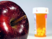Apple and pill bottle stock images