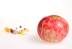 Apple or Pills ? Stock Image