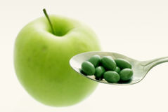 Apple or pills? Royalty Free Stock Photography