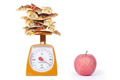 Apple and Pizza slices Royalty Free Stock Image