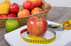 Apple placed on a scales,. Apple placed on a scales and meter Stock Images