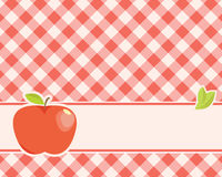 Apple on a plaid background Royalty Free Stock Photo