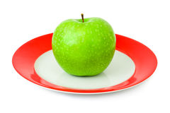 Apple on plate Royalty Free Stock Images