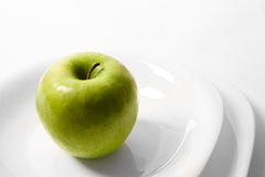 Apple on a plate Stock Photos