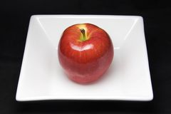 Apple on plate Stock Image