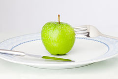 Apple on plate Royalty Free Stock Photo