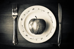 Apple on plate Royalty Free Stock Image