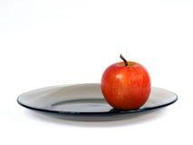 Apple on plate Stock Photo