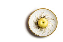 Apple on the plate Royalty Free Stock Photos