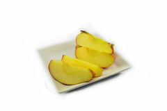 Apple in plate Stock Image