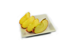Apple in plate Stock Images