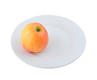 An apple on the plate Stock Images