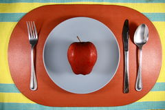 Apple on a Plate Royalty Free Stock Photography