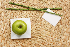 Apple on plate with rattan Royalty Free Stock Images