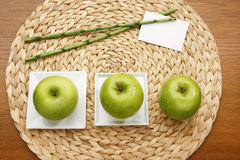 Apple on plate with rattan background decoration Stock Images