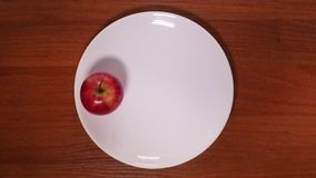 Apple on the Plate. Top Shot. Stop Motion stock footage