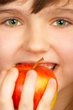 Apple pleasure. Cute child with a red apple Stock Photo
